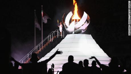 TOKYO, JAPAN - JULY 23: Naomi Osaka of Team Japan lights the Olympic cauldron with the Olympic torch during the Opening Ceremony of the Tokyo 2020 Olympic Games at Olympic Stadium on July 23, 2021 in Tokyo, Japan. (Photo by Matthias Hangst/Getty Images)