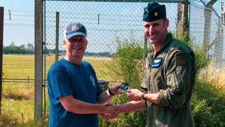Photographer Ian Simpson meets fighter pilot Maj. Grant Thompson on July 20, 2021 after Simpson made a potentially lifesaving intervention when he spotted something wrong with Thompson's F-15E Strike Eagle fighter jet.