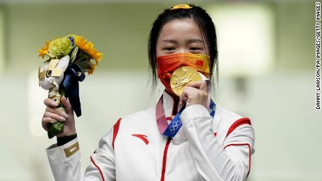China's Yang Qian celebrates with her gold medal after winning the 10m Air Rifle Women's Final on the first day of the Tokyo 2020 Olympic Games.