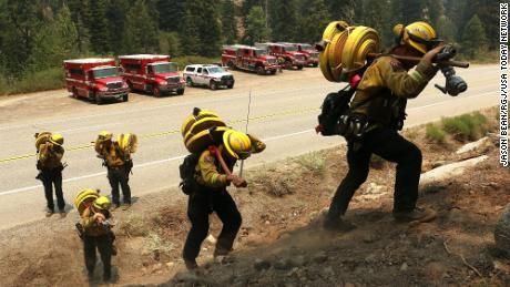 A Cal Fire crew works to keep the Tamarack Fire from crossing Highway 88 just west of Woodfords in Alpine County, California, on July 23, 2021.