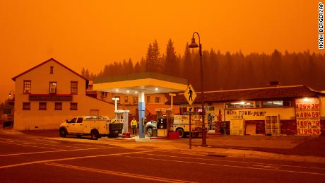 Firefighters gas up while battling the Dixie Fire in the Greenville community of Plumas County, California, on July 23, 2021.