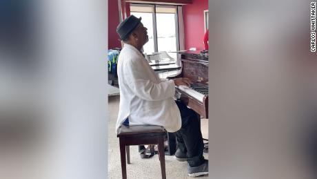 Carter plays piano at a pizzeria and bar on Concourse A at Hartsfield-Jackson Atlanta International Airport.