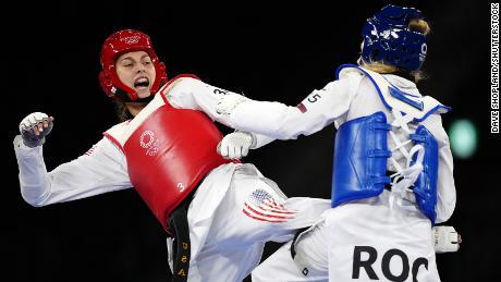 Tatiana Manina and Anastasija Zolotic compete in the women's -57kg taekwondo gold medal contest.