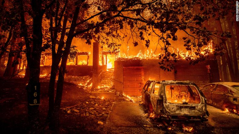 Flames consume a home as the Dixie Fire tears through the Indian Falls community in Plumas County.