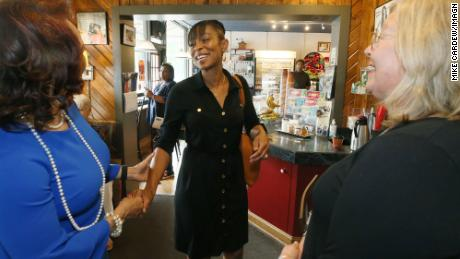 Shontel Brown, candidate for Ohio's 11th District, greets Akron city council members Ginger Baylor, at-large, and Nancy Holland, Ward 1 at Angel Falls Coffee shop in Akron on July 14, 2021.