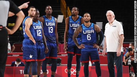 From left, Zachary Lavine, Jrue Holiday, Bam Adebayo, Kevin Durant, Damian Lillard, and head coach Gregg Popovich of Team USA look on in disbelief during their game against France on Sunday, July 25.