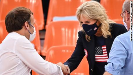 French President Emmanuel Macron and Biden shake hands ahead of the women's first round 3x3 basketball match between the US and France.