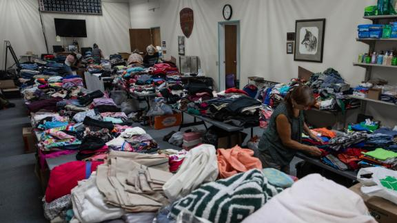 Volunteers sort clothing at a donation shelter for those affected by the Bootleg Fire in Bly, Oregon.