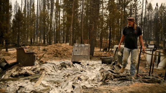 Scott Griffin surveys his property, which was destroyed by the Bootleg Fire in Sycan Estates, Oregon.