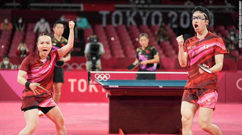 Mizutani Jun and Mima Ito of Japan cheer during the table tennis mixed doubles final against China on July 26.