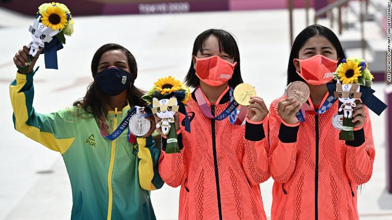 (LtoR) Brazil's Rayssa Leal (silver), Japan's Momiji Nishiya (gold) and Japan's Funa Nakayama (bronze) pose during the medal ceremony of the podium ceremony of the skateboarding women's street final of the Tokyo 2020 Olympic Games at Ariake Sports Park in Tokyo on July 26, 2021. (Photo by Jeff PACHOUD / AFP) (Photo by JEFF PACHOUD/AFP via Getty Images)