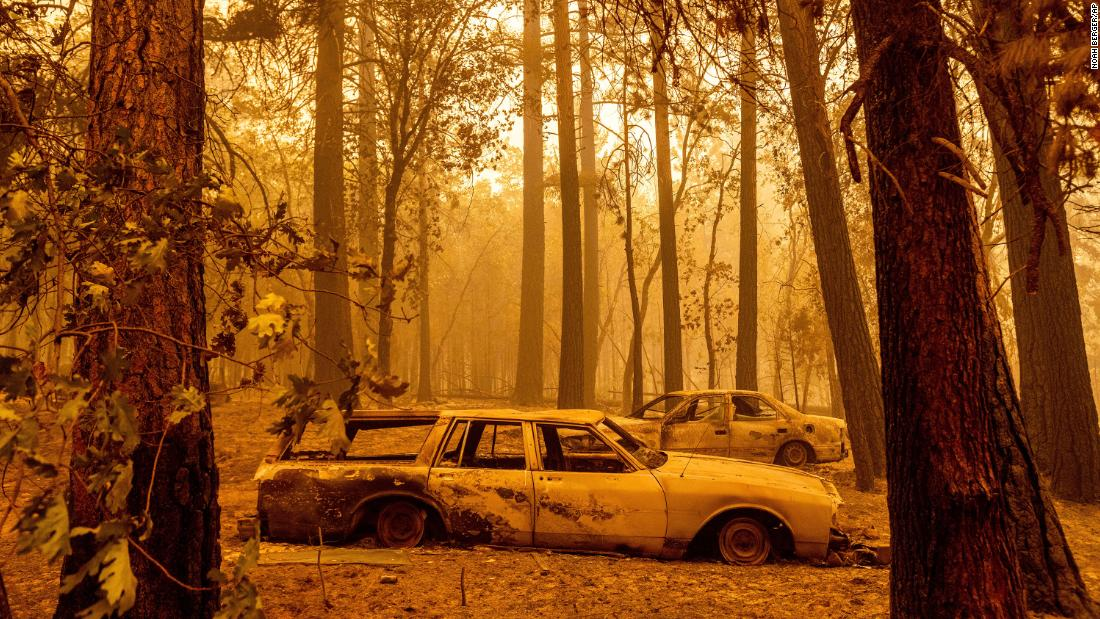 As two California wildfires merge and a small community is threatened, firefighters face dangerous conditions