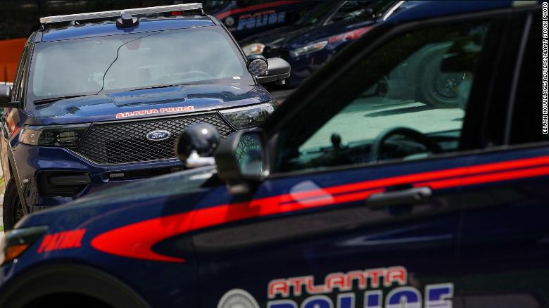 An Atlanta police officer and sergeant were removed from duty after video surfaced showing a woman being kicked in the head