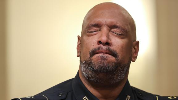US Capitol Police officer Harry Dunn becomes emotional as he testifies before the committee Tuesday.