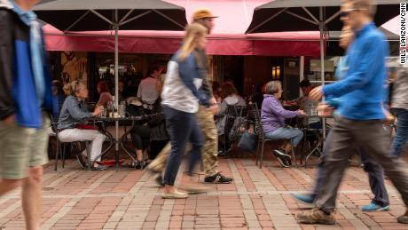 People dine outside on Church Street in downtown Burlington.