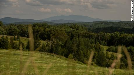 Mountains rise over the Vermont countryside in Caledonia County. Neighboring Essex County has the lowest vaccination rate in the state.