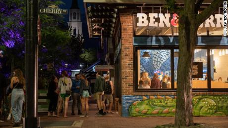 People wait in line for Ben & Jerry's ice cream in downtown Burlington.