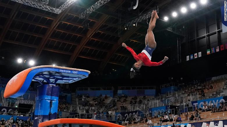 Simone Biles, of the United States, performs on the vault during the artistic gymnastics women's final at the 2020 Summer Olympics, Tuesday, July 27, 2021, in Tokyo. (AP Photo/Ashley Landis)