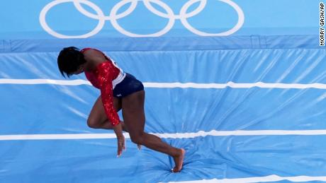 Biles stumbles as she lands during the artistic gymnastics women's final at the 2020 Summer Olympics on Tuesday