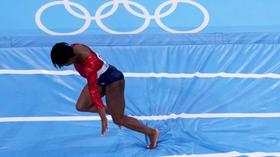 Simone Biles stumbles as she lands on the vault during the artistic gymnastics women's final at the 2020 Summer Olympics.