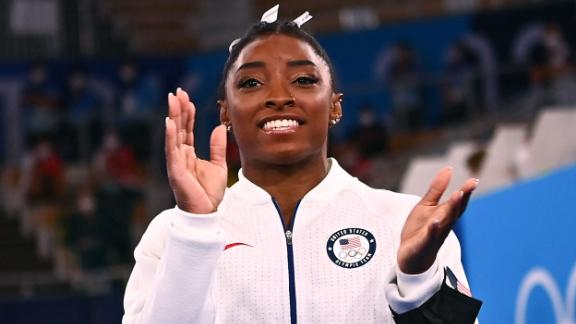 Simone Biles applauds during the artistic gymnastics women's team final during the 2020 Olympic Games.