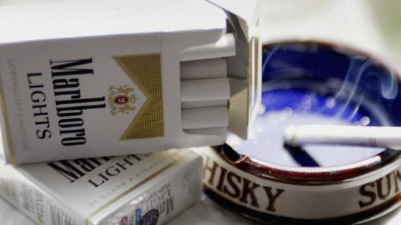 """CHICAGO, IL - APRIL 15:  Cigarette maker Phillip Morris USA announced it has started removing the controversial words """"lowered tar and nicotine"""" from packages of Marlboro Lights (it appears on the lower front area of the package) and other """"light"""" cigarette brands. Phillip Morris USA was recently ordered by an Illinois judge to pay $10.1 billion in damages for misleading smokers into believing """"light"""" cigarettes were safer than regular cigarettes.  (Photo by Scott Olson/Getty Images)"""