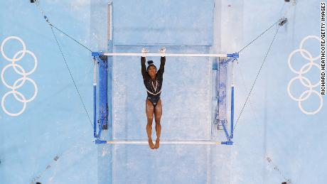 Biles trains on the uneven bars ahead of the Tokyo 2020 Olympic Games on Thursday, July 22.