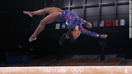 Biles competes on the balance beam at the Tokyo 2020 Olympic Games on Sunday, July 25.