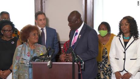 Civil rights attorney Benjamin Crump and National Council of Negro Women executive director Janice Mathis (left) host a press conference at the group's Washington D.C. office on July 27 after filing a lawsuit against Johnson & Johnson.