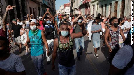 After historic protests, defiant Cubans face mass trials