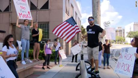 Anti-mask protesters gathered at the Broward School Board headquarters before a board meeting in Fort Lauderdale, Florida, on July 27.