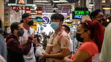 Visitors to the Grand Central Market in Los Angeles are mostly masked on Tuesday.