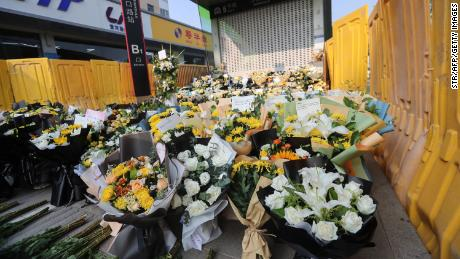 Flowers are placed as tributes in front of Shakou Road subway station in memory of flood victims in Zhengzhou.
