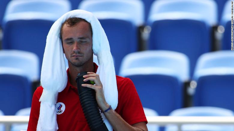 MEDVEDEV Daniil of ROC (Russian Olympic Committee) takes part in men's singles third round against FOGNINI Fabio of Italy at Ariake Tennis Park in Tokyo on July 28, 2021. MEDVEDEV Daniil won the match in the heat. ( The Yomiuri Shimbun via AP Images )