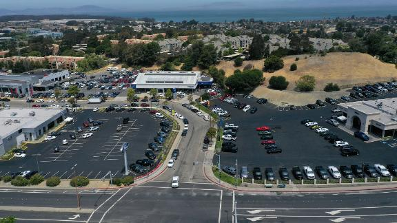 Lots at car dealers sit nearly empty in California.