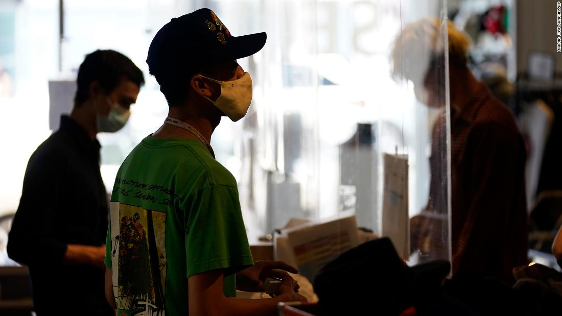 New mask guidance throws stores' policies into flux