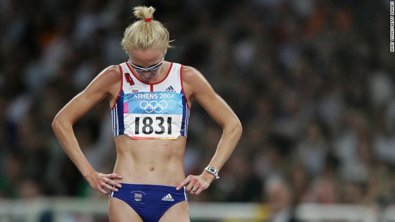 ATHENS - AUGUST 27:  Paula Radcliffe of Great Britain looks dejected after she pulled out of the women's 10,000 metre event on August 27, 2004 during the Athens 2004 Summer Olympic Games at the Olympic Stadium in the Sports Complex in Athens, Greece. (Photo by Andy Lyons/Getty Images)