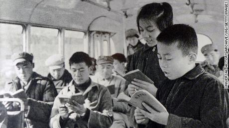 Chinese teenagers reciting Chairman Mao's quotations on a bus during the Cultural Revolution in 1968.