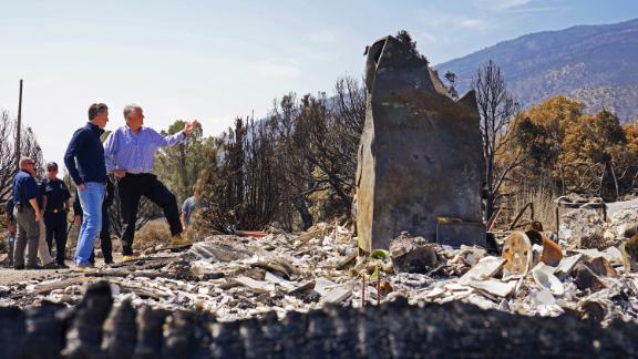 California Gov. Gavin Newsom, left, and Nevada Gov. Steve Sisolak tour an area destroyed by the Tamarack Fire in Gardnerville, Nevada, on Wednesday, July 28.