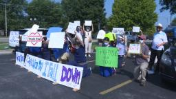 Cox South COVID-19 employees greeted by supporters providing prayers and indicators of encouragement