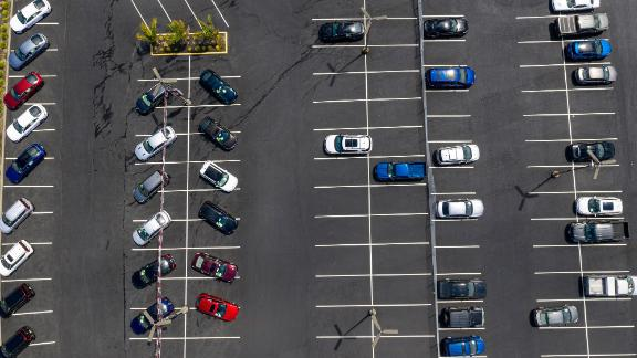 Vehicles in a nearly empty lot at a car dealership in California.