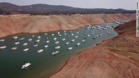 Houseboats sit in low water on Lake Oroville as California's drought emergency worsens