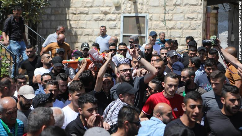 Palestinian man shot dead in violent clashes as 12-year old boy, also killed by Israeli soldiers, is buried