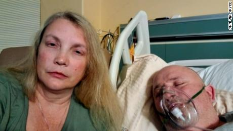 Alicia Ball sits beside her husband, William, in a Mississippi hospital battling  Covid-19.