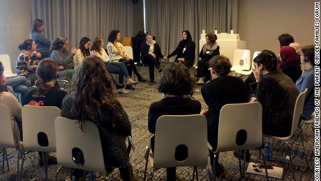 """In a pre-pandemic photo, members of the Parents Circle - Families Forum participate in a dialogue meeting. """"Everything from the Parents Circle, all the work is always from both sides,"""" Robi Damelin tells CNN."""