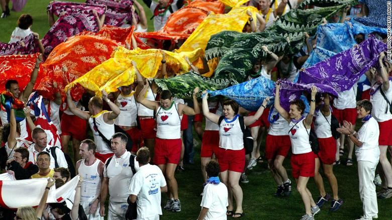 Participants From The United Kingdom Team March Onto The Field During The Opening Ceremony Of The 2002 Gay Games In Sydney, Australia.