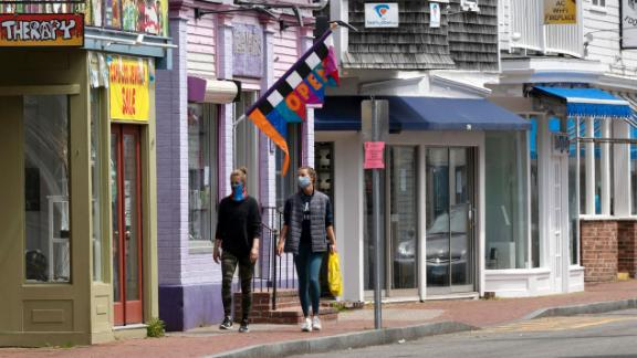 Closed retail stores line the usually crowded Commercial Street, Monday, May 25, 2020, in Provincetown, Mass. (AP Photo/Michael Dwyer)