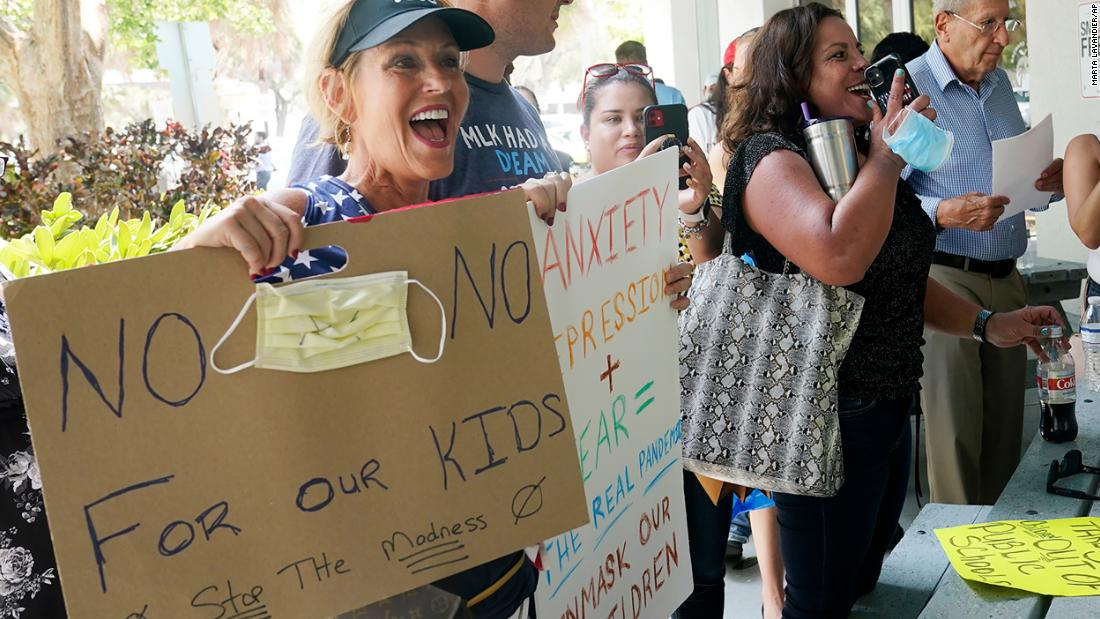 As Covid-19 cases surge in Florida, governor says parents should decide whether their children wear masks to school