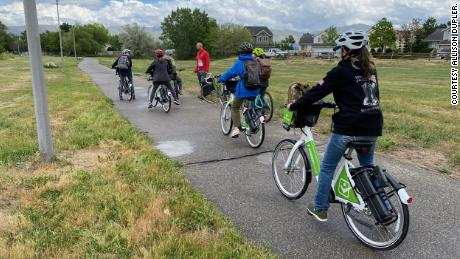 The volunteers ride bikes as well to reach other camp sites.