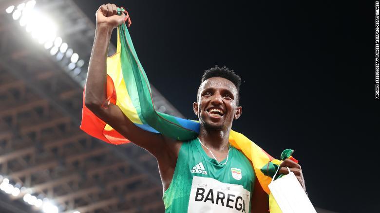 Selemon Barega celebrates 10,000-meter gold at the Tokyo Olympics.